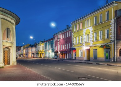 Old colorful houses located opposite to historic trading arcades on Koltsova street at dusk in Ryazan, Russia