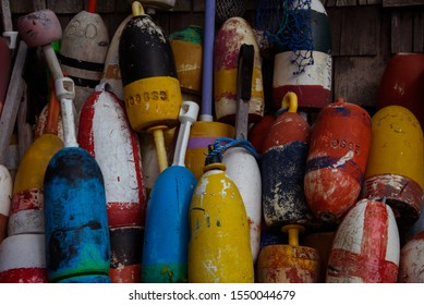 Old colorful lobster buoys in New England coast