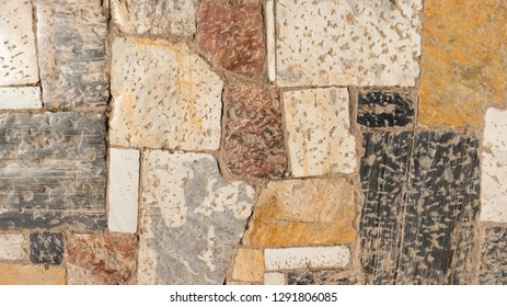 Old and colorful marble pavement at the Acropolis, Athens