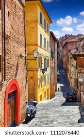Old colorful narrow street in Siena, Tuscany, Italy. Siena beautiful architecture