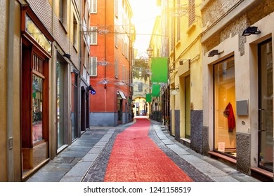 Old colorful street with shops in Parma, Emilia-Romagna, Italy