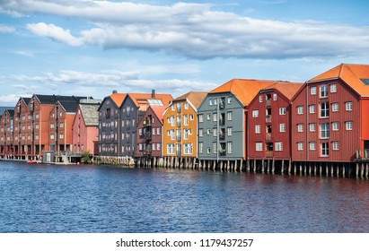 Old colorful wooden warehouses on the river Nidelva in Trondheim city, Norway.