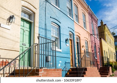 Old Colourful Row Houses with Brick Steps Leading to Wooden Front Doors on a Sunny Fall Day. Georgetown, Washington DC.