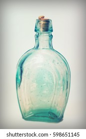 Old colourful vintage bottles against a white background