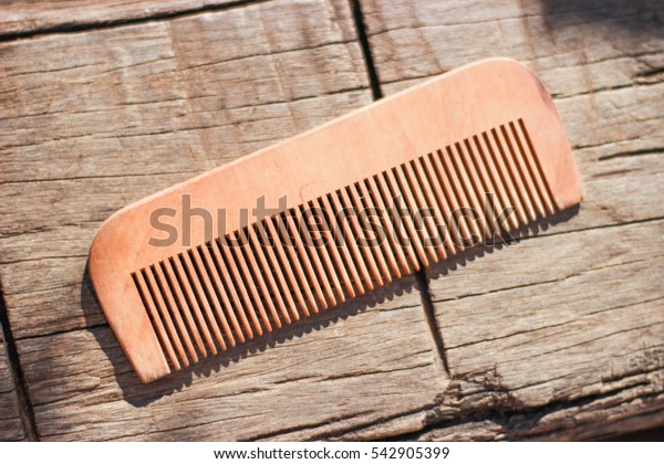 Old comb with wooden floors