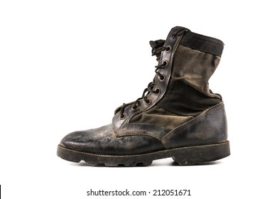 Old combat boots isolated on white background.