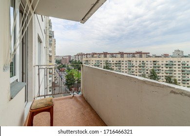Old common open balcony in high residential apartment building maid of cement