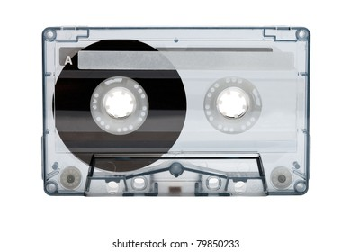 Old compact audio cassette (tape), macro shot on white background, empty