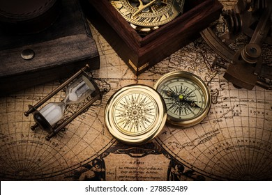 Old compass, astrolabe on vintage map. Retro stale.