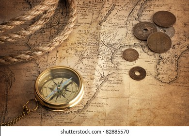 old compass, old coins and rope on vintage map ( Africa 18 century author Ion.  Matthia Hasio)