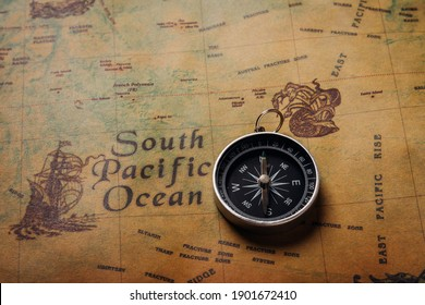Old compass discovery on vintage paper antique world map background, Retro style cartography travel geography navigation, Pirate navigate the geography, Columbus Day concept