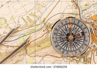 Old compass and instruments for measuring on a topographic map