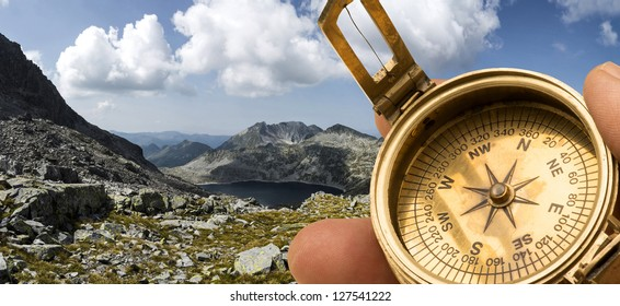 Old compass in the mountain