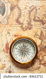 Old compass on ancient map. A compass with the antique image of a direction
