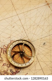 Old compass on map