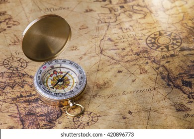 Old compass on map.
