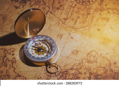old compass on vintage map.