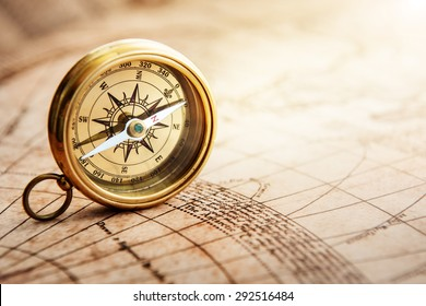 Old compass on vintage map. Retro stale. Shot with shallow depth of field.
