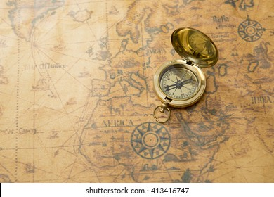 old compass on vintage map