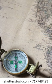 Old compass on vintage map. Retro style