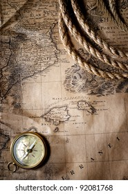 old compass on vintage map, 1732 Spain and Portugal, (author Ioh.Bapt.Homann) Nuremberg, Germany