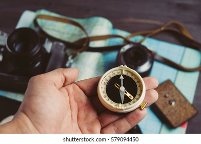 Old compass and photo equipment. Travel concept