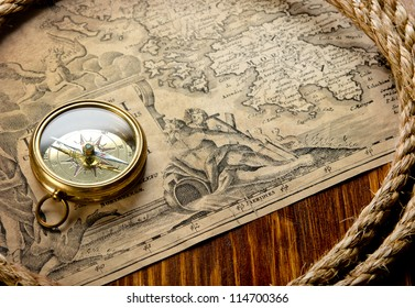 old compass and rope on vintage map 1733