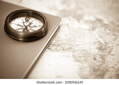 Old Compass On Vintage World Map Stock Photo Edit Now 1031885350