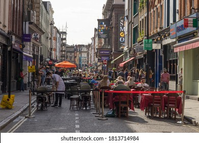 Old Compton street in Soho with outside drinking and dining during the daytime. London - 12th September 2020