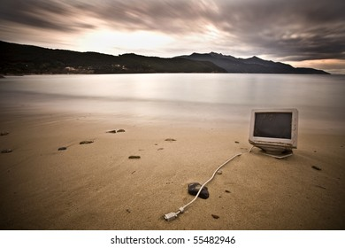 """an old computer abandoned on a beach during winter. It also reminds me the popular """"If you were stranded on an island what is the one thing that you would take with you?"""""""