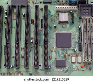 Old computer board with soldered elements