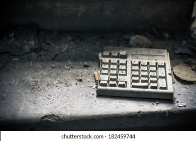Old computer keyboard in abandoned room