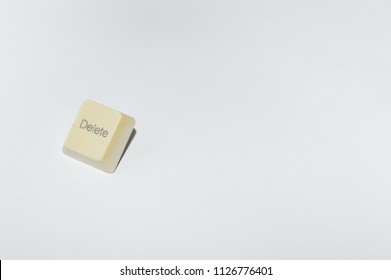 "old computer keyboard ""delete"" key isolated on white background"