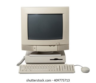 Old computer. The system unit, monitor, keyboard and mouse isolated on white background.