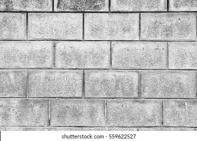 Old concrete block wall background and texture