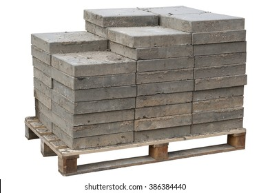 The old concrete paving blocks  are accurately put on wooden  pallet. Isolated. After repair of the sewerage the tile will be put on the place.