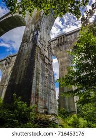 Old concrete railway bridge seen from below