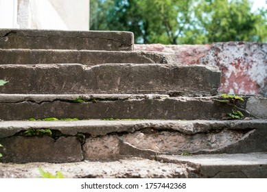 Old concrete stairs crumble from old age and poor repairs, you need good craftsmen to replace the stairs or repair them. Close up