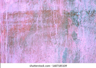 Old concrete wall. Peeling plaster on wall of house, building or fence surface. Toning in bright neon pink and blue colors. Modern urban backdrop. Copy space. Place for text. Selective focus image.