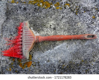 Old construction brush with worn bristles. Flat brush with artificial bristles.