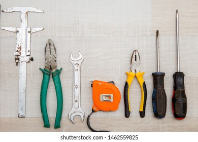 old construction tools on vintage background