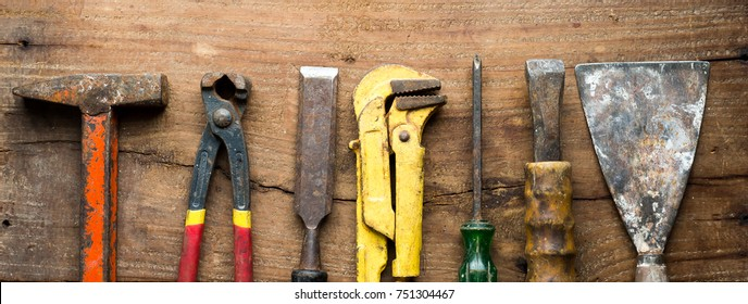 Old construction tools on wood background real estate business