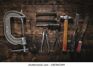 Old construction tools on a wooden table background. Carpenter table. Woodwork.