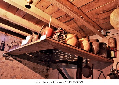 old containers of rural food, old country kitchen with hanging pans,old wooden cupboard in the kitchen of a rural house in Galicia, old wooden furniture,  typical rural cuisine of Galicia,