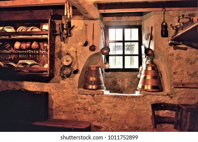 old containers to store the water, sellas, old wooden cupboard in the kitchen of a rural house in Galicia, old wooden furniture, old food storage containers, typical rural cuisine of Galicia,
