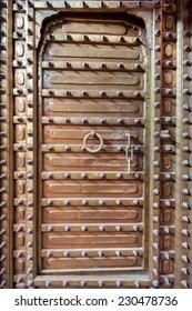 old copper door with spikes