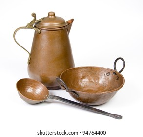 Old copper jug, ladle and bowl isolated on white