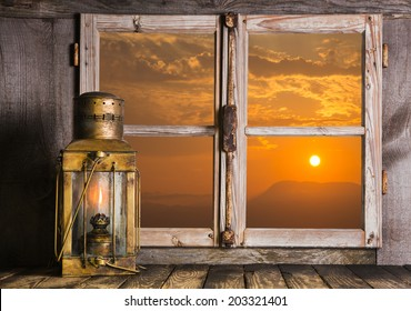 Old copper lantern on Windows sill: view outdoor when the sun rise up. Concept for dreams, feelings or mourning.