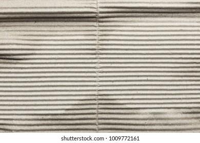 Old corrugated cardboard, horizontal stripes, texture background