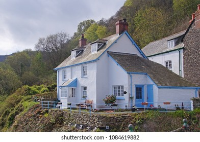 Old cottage white washed facade and light blue lines in the fishing village of Clovelly in Devon, England